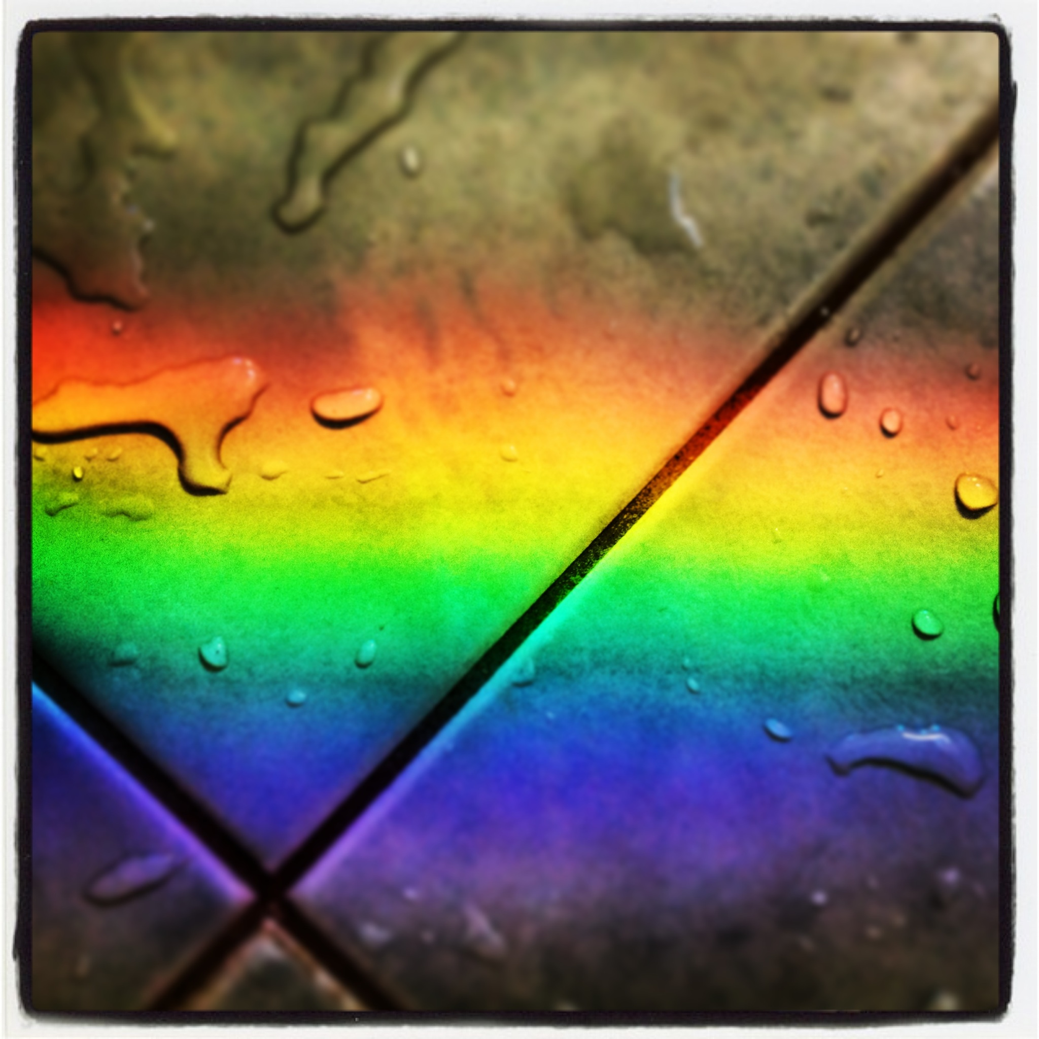 Rainbow over wet tiles
